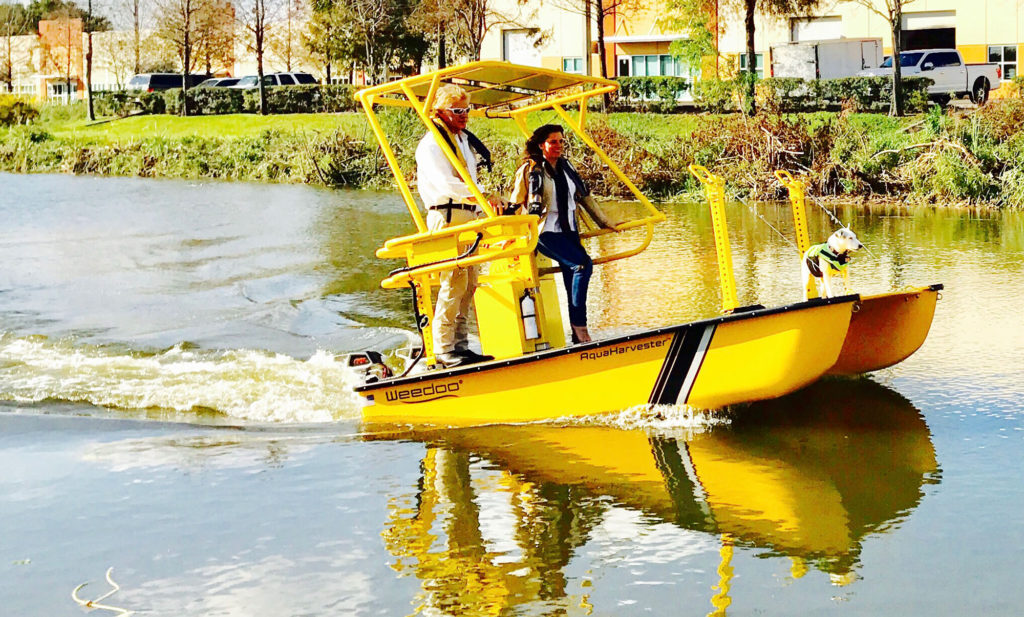 Weedoo AquaHarvester Safety Boat Patrolling The Water