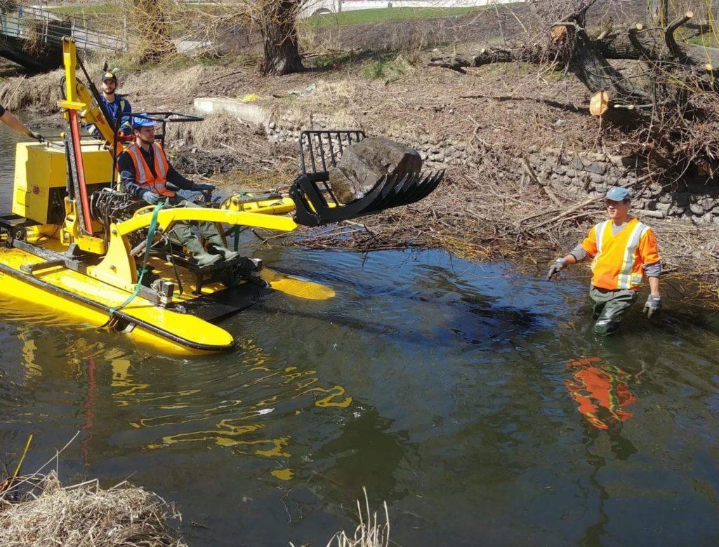 Waterway cleanup including boulders